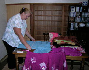 Wendy Carroll helping to measure kimono widths