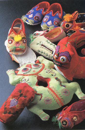 Assortment of embroidered toys and children's clothing from China