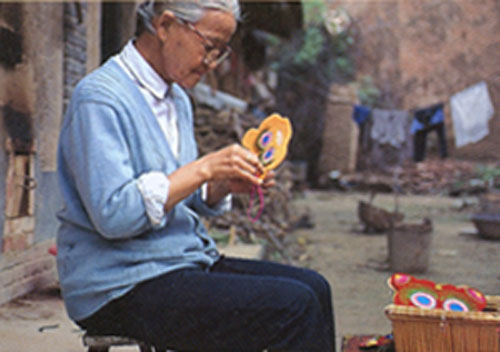 Chinese woman sewing