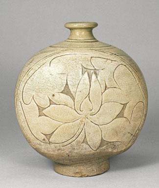 Round flask with lotus design carved into white slip coating, Koryo Museum, Kyoto, Japan