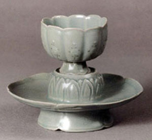 Celadon tea cup in the shape of a lotus resting on a celadon saucer shaped like a lotus leaf, Koryo Museum, Kyoto, Japan
