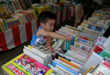 A young book-lover at the used book fair at Shimogamo shrine, Kyoto