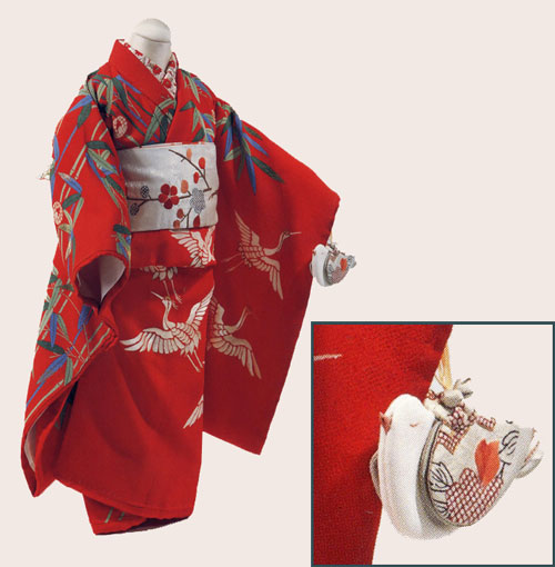 little girl's kimono with inset showing close-up of her little bird purse